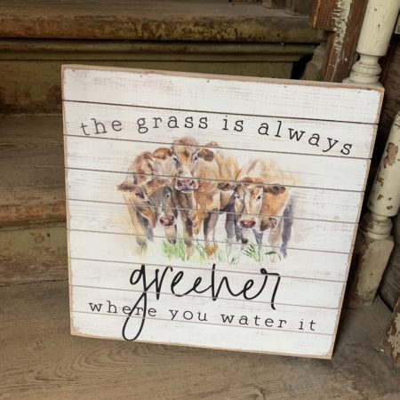 The grass is always greener where you water it w/ cows plaque